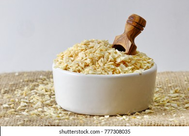 Dehydrated Onion flakes in a ceramic bowl