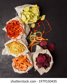 Dehydrated vegetables in textile bags on black background
