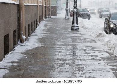 De-icing chemicals on the winter road/ Pavement is sprinkled with technical salt or salt mixtures based on it/ Reagent - technical salt will make the road safe/ Effective tool to fight ice on roads