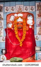 A deity of Hanuman, the Hindu monkey god, in a shrine in Haridwar.