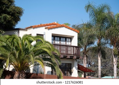 Del Mar, California / USA, 10-30-2018 A typical Southern California, Spanish style home is seen peaking out of the palms in Del Mar California.