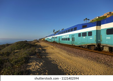 Del Mar, California, USA - February 5, 2018: The Coaster commuter train that operates in the central and northern coastal regions of San Diego County passing through Del Mar Heights