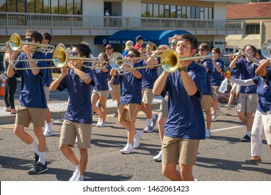 Del Norte High School Nighthawks Marching Band, 4th July Independence Day Parade at Rancho Bernardo, San Diego, California, USA.  Young student parading with flags and playing music 07/04/2019