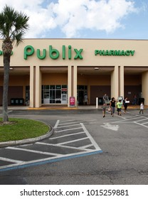 DELAND, FLORIDA, USA - MARCH 13, 2015: People outside Publix supermarket in Deland city, Florida