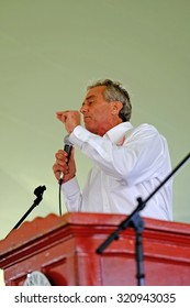 DELANO, CA - SEPTEMBER 26, 2015: Guest speaker, Robert F Kennedy, Jr, talks to the assembled UFW members and supporters gathered for the 50th anniversary of the Delano Grape Strike.