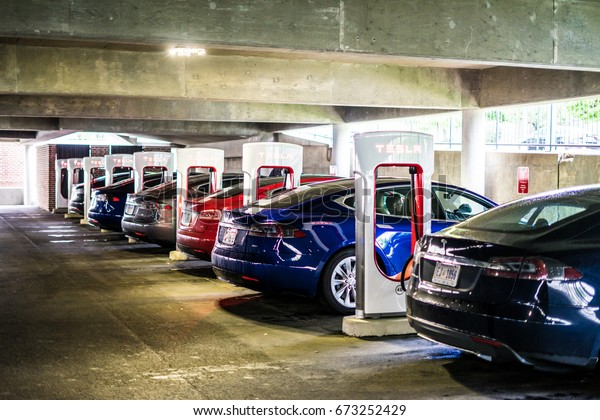 DELAWARE, USA - APRIL 24, 2017: Charging the electric car at the Super Charging station. Charging at Super Charging station takes a few minutes, and the charge complains for hundreds of miles.