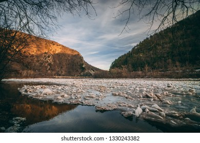 The Delaware Water Gap iced over during the winter. The mountains come together with a river running through them.