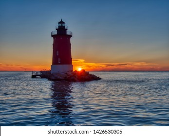 Delaware's Breakwater East End Lighthouse is no longer operational but remains an impressive landmark in Lewes, Delaware and even more so at sunset.