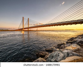Delaware's Indian River Inlet bridge in the light of a summer sunset.