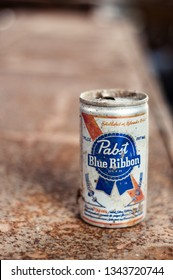 DELCAMBRE, L.A. / USA - MARCH 14, 2019: Antique, rusted, dirty small can of Pabst Blue Ribbon beer. Beer can with an open top. Empty beer can.