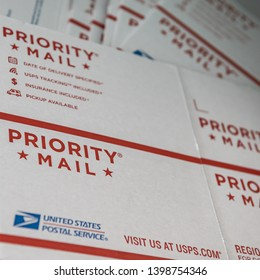 DELCAMBRE, L.A. / USA - MAY 08, 2019: Priority mail letter box, USPS white, flat, cardboard boxes for shipping Priority Mail.
