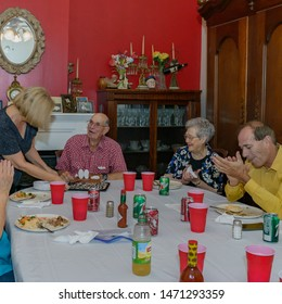 DELCAMBRE, L.A. / USA - MAY 10, 2015: An older man, senior citizen at a birthday celebration for a 90th birthday party, with a cake and candels, at a location in South Louisiana.
