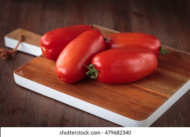 Delcious fresh raw San Marzano tomatoes for an healthy nutrition