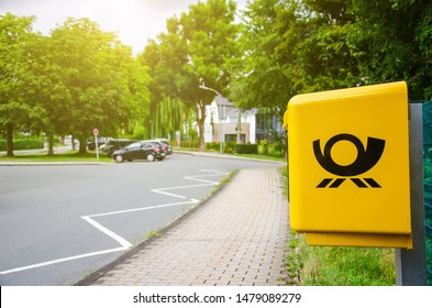 Delecke, Germany - August 1, 2019: Deutsche Post Mailbox. The Deutsche Post AG, operating under the trade name Deutsche Post DHL Group, is a German postal service and international courier service.
