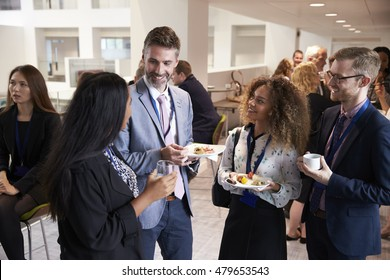 Delegates Networking During Conference Lunch Break - Shutterstock ID 479653543