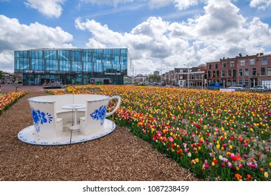 DELFT, the NETHERLANDS - APRIL 26, 2018: A tulip garden in front of the new townhall / railway station in Delft, the Netherlands.