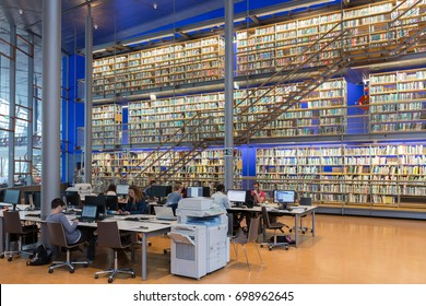 DELFT, THE NETHERLANDS - AUGUST 19, 2017:  Students at work in the Library of the Technical University Delft, The Netherlands