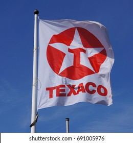 Delft, the Netherlands. August 2017. Texaco logo and brand name on a flag.