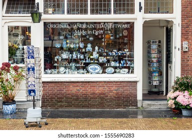 DELFT, NETHERLANDS - AUGUST 25, 2018: Window display of traditional Dutch handpainted pottery shop in Delft, Netherlands