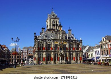 Delft, the Netherlands - August 5, 2020: The city hall of the Dutch city of Delft against a clear blue sky.