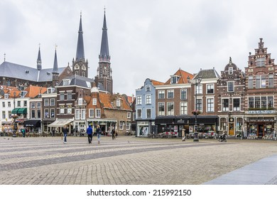 DELFT, NETHERLANDS - JUNE 17, 2014: Old houses, stores and restaurant on the Markt (central square) of Delft, Holland.