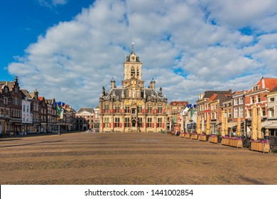 Delft, Netherlands - June 17, 2019: City Hall and Market Square in Delft, South Holland, Netherlands. Delft is an old Dutch city that is known for its pottery, canals and the painter Vermeer.