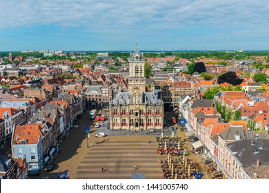 Delft, Netherlands - June 17, 2019: High angle view on Market Square and City Hall in Delft, Netherlands. Delft is an old Dutch city, known for its pottery, canals and the painter Johannes Vermeer.