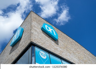 DELFT, THE NETHERLANDS - June 21, 2018: Albert Heijn sign at branch. Albert Heijn is the largest Dutch supermarket chain and a key brand of Ahold Delhaize, an international food retail group.