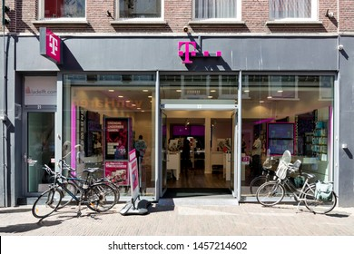 DELFT, THE NETHERLANDS - JUNE 29, 2019: T-Mobile Shop. T-Mobile is the brand name used by the mobile communications subsidiaries of the German telecommunications company Deutsche Telekom AG.