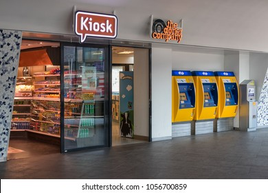 Delft, The Netherlands - march 15, 2018: Kiosk and three yellow ticket machines at Dutch railway station of Delft