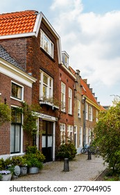 DELFT, NETHERLANDS - MAY 2, 2015: Beautiful architecture of Delft, Netherlands. Delft is a popular touristic destination due to the town centre with canals