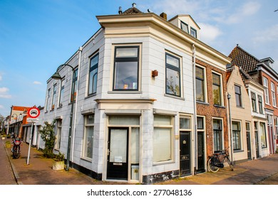 DELFT, NETHERLANDS - MAY 2, 2015: House in the center near canal of Delft, Netherlands. Delft is a popular touristic destination due to the town centre with canals