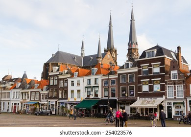 DELFT, THE NETHERLANDS - NOV 10, 2014: City landscape of Markt (central square). Delft - beautifully preserved historic city - from a rural village in the early Middle Ages Delft developed to a city.