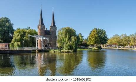 DELFT, NETHERLANDS - SEP 21, 2019 : Historical Eastern Gate and drawbridge over the canal in Delft, Netherlands. This gate build around 1400 is the only remaining city gate of Delft.