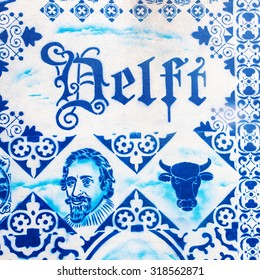 DELFT, NETHERLANDS - SEPTEMBER 04, 2015: painted Delft pottery seen at a wall in the old town. Delft pottery is blue and white tin-glazed pottery made in and around Delft from 16th century
