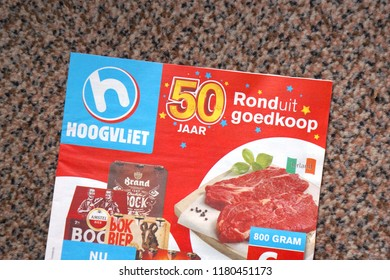 Delft, the Netherlands. September 2018. A brochure from Hoogvliet, a Dutch grocery shop, on a doormat.
