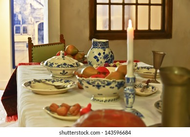 DELFT, NETHERLANDS-APRIL 14: A view of a table setting of Delftware in the Delft pottery factory on April 14, 2013. Royal Delft is the last remaining Delftware factory from the 17th century.