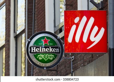 DELFT/NETHERLANDS - April 16, 2014: Heineken and Illy advertising signs at a cafe restaurant
