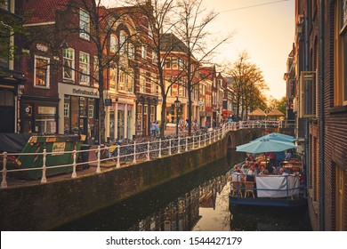 DELFT/NETHERLANDS - April 19, 2018: Boat restaurant on the narrow canal of Delft town