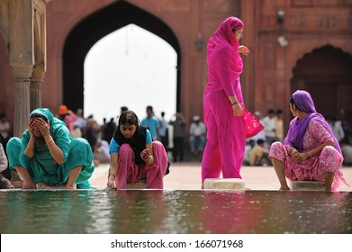 DELHI - AUG 08: unidentified women clean themselves in the courtyard of Jama Masjid Mosque on August 8, 2009 in Delhi, India.