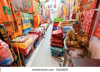 DELHI - FEBRUARY 12: Shopkeeper inside shop selling textile on February 12, 2008 in Delhi, India.  India's Textile Exports have grown exponentially over the last decade.