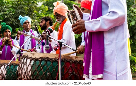 Delhi, India; 10th Aug 2014 - Traditional north indian musicians playing local instruments. The colorful dresses are traditionally worn during festivals or when performing