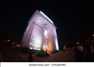 Delhi, India - 18th Aug 2018: People roaming around the famous monument of india gate at night. Shot with a fisheye this showcases the beautiful lights of this picnic spot and landmark