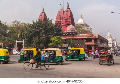 DELHI, INDIA - 19TH MARCH 2016: A view of streets and the Shri Digambar Jain Lal Mandir Temple in Delhi. Lots of Tuk Tuk Rickshaws and traffic can be seen.