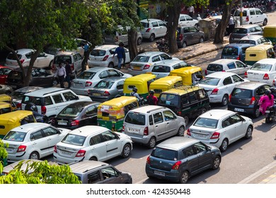 DELHI, INDIA - 19TH MARCH 2016: Traffic jams in central India during the day. Tuk Tuk Rickshaws, motorbikes, cars and people can be seen.