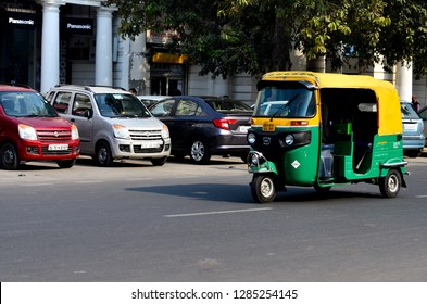 Delhi, India, 2019. Emphatic looking CNG fueled autorickshaw, racing on the road, is a popular urban transportation on Indian roads, Mumbai, Pune, Lucknow, Jaipur, Hyderabad, Banglore.