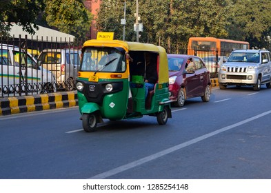 Delhi, India, 2019. Emphatic looking CNG fueled autorickshaw, racing ahead on the road, is a popular urban transportation on Indian roads, Mumbai, Pune, Lucknow, Jaipur, Hyderabad, Bangalore, Gurgaon