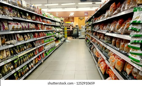 Delhi, India, 2019. Popular FMCG brands displayed on aisle in a modern grocery outlet at a mall. Products displayed here are the epitome of visual merchandising, shelf placement and availability