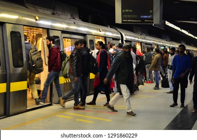 Delhi, India, 2019. Side angle shot of people getting off the train in a busy metro station. Metro is modern transport for people in Jaipur, Lucknow, Kolkata, Hyderabad, Mumbai and Banglore