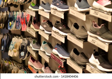 Delhi, India, 2019. Sketchers sports shoes displayed in rows in a sports shop in a Mall.